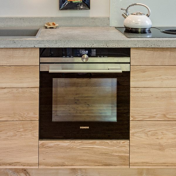 A Handmade hardwood contemporary kitchen from Ash with cast concrete work-surface made by HOUT Design in Cumbria