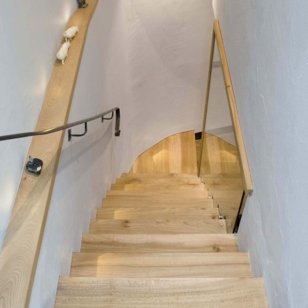 A bespoke hardwood staircase designed and made from Elm in Cumbria by HOUT Design