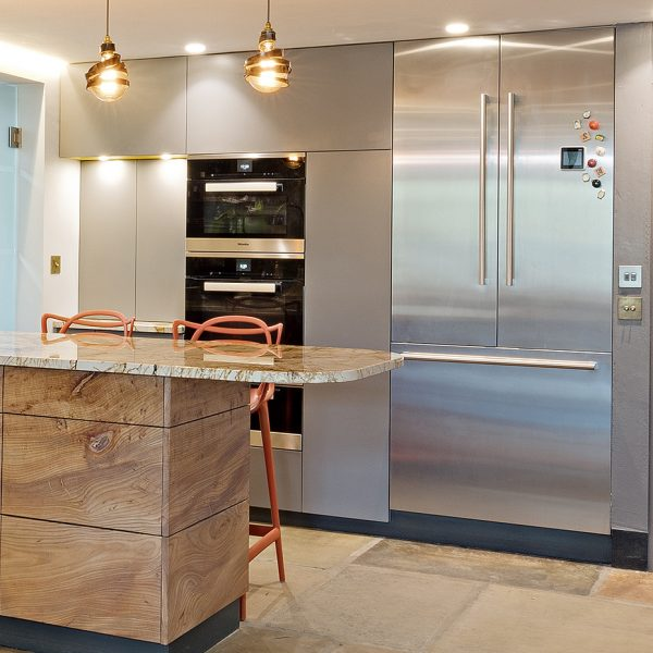 A bespoke handmade kitchen from Elm with fitted kitchen cabinets made by HOUT Design in Cumbria