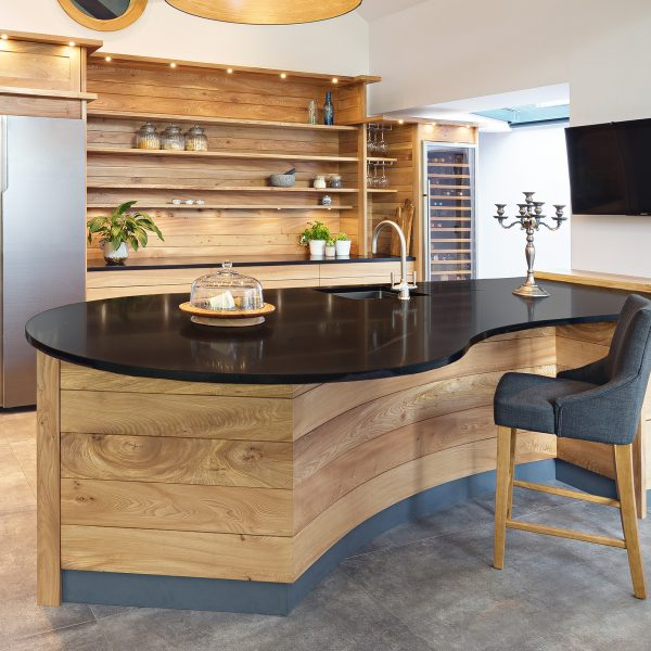 A bespoke hardwood kitchen Island peninsula made from Elm in Cumbria by HOUT Design