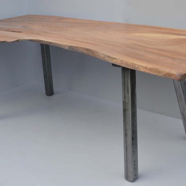 A natural edged slab table made from Elm by HOUT Design in Cumbria