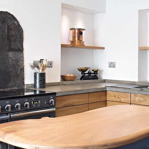 A bespoke hardwood Kitchen with Concrete worktops handmade in Cumbria by HOUT Design