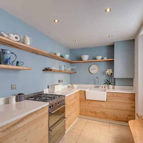 A bespoke fitted Kitchen handcrafted from Elm and made in Cumbria by HOUT Design