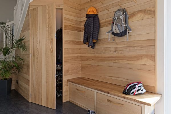 A bespoke hardwood lobby storage unit made from Ash in Cumbria by HOUT Design