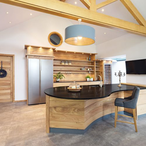 A contemporary handmade hardwood kitchen Island made from Elm in Cumbria by HOUT Design