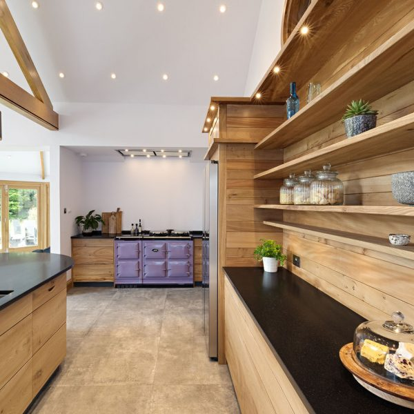 A contemporary handmade hardwood kitchen made from Elm in The Lake District by HOUT Design