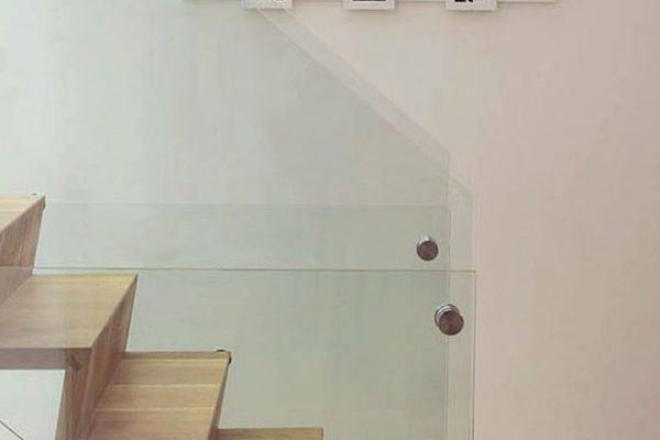 A Glass Supported Oak Staircase made in Lancashire by HOUT Design