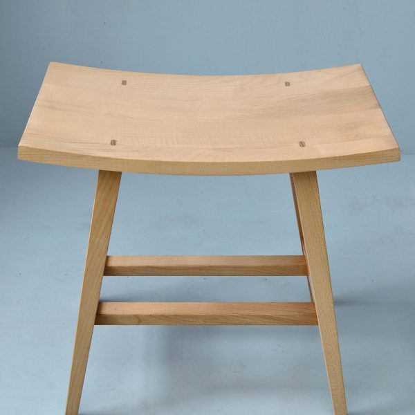 A wooden stool made from Sycamore by HOUT Design in Cumbria